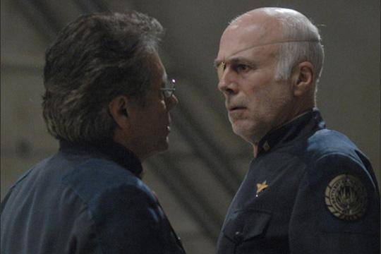 Admiral Adama (James Lee Olmos) and Sol Tight (William Hogan)