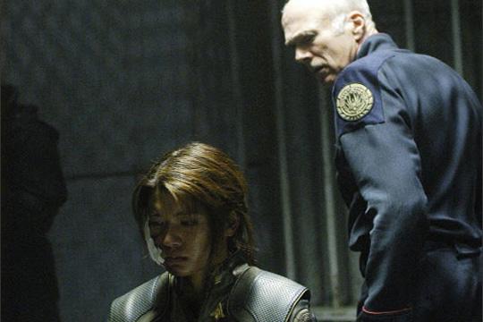 Sol Tigh (Michael Hogan) interrogates Boomer (Grace Park)