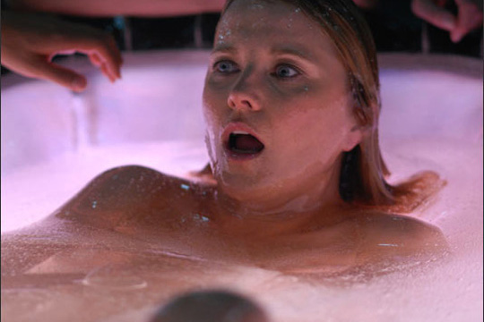 A Three (Lucy Lawless) wakes in a resurrection pod